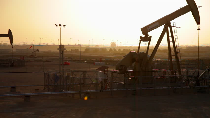Oil Pumps working at Sunset in Bahrain