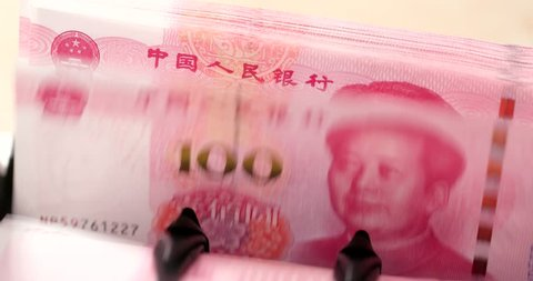 Checking number of hundred chinese banknote on machine