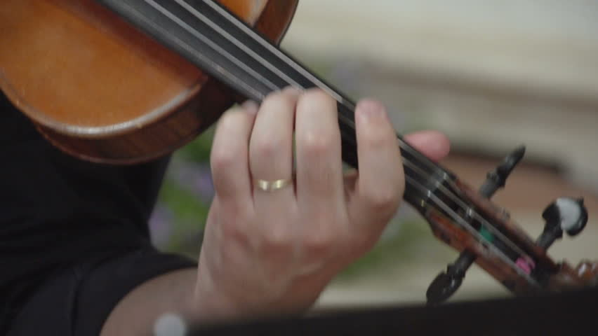 Close up shot of hand playing arpeggios on violin