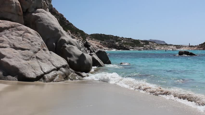 Waves crashing at a beautiful beach in sardinia
