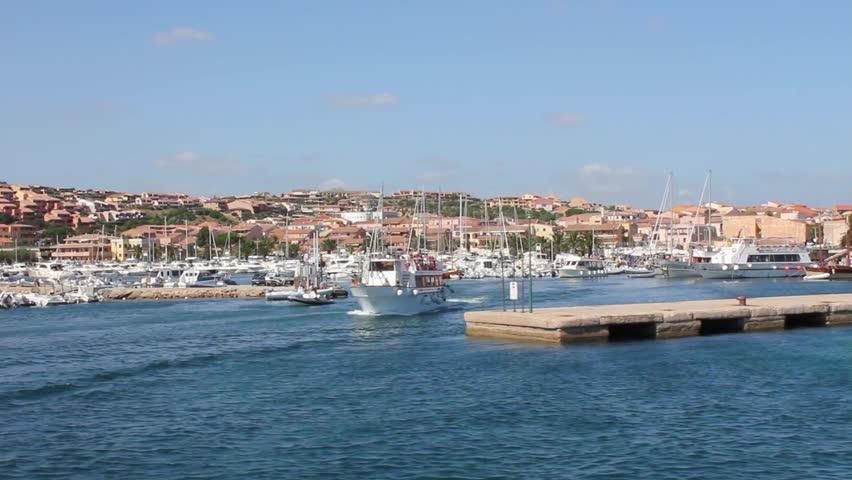 Boat leaving the port in sardinia