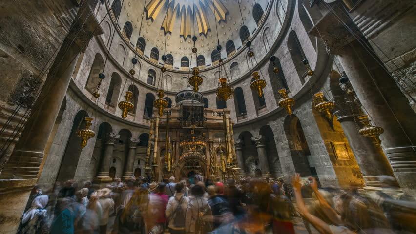 Jerusalem 10.03.2018: Pilgrims at the church of the Holy Sepulchre in Jerusalem, 4k time lapse