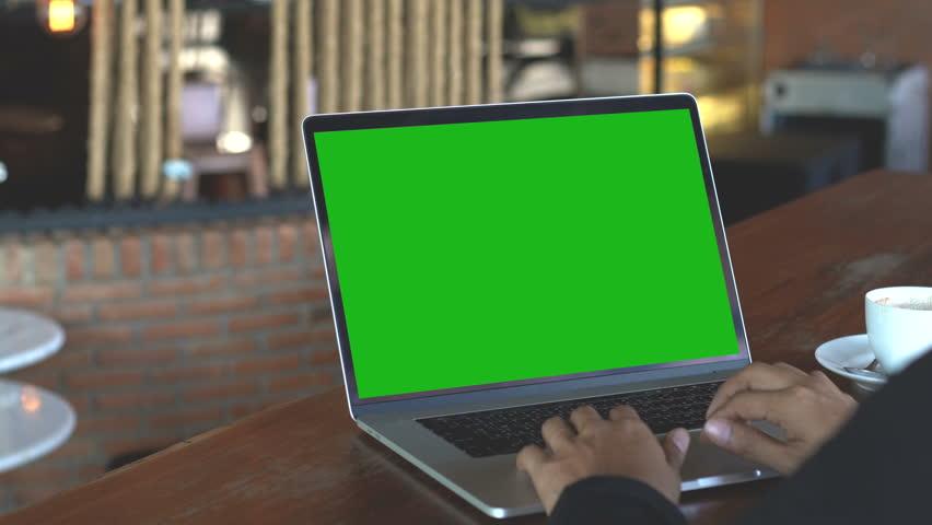 Hand typing on laptop keyboard showing green screen, 4k | Shutterstock HD Video #1008851729