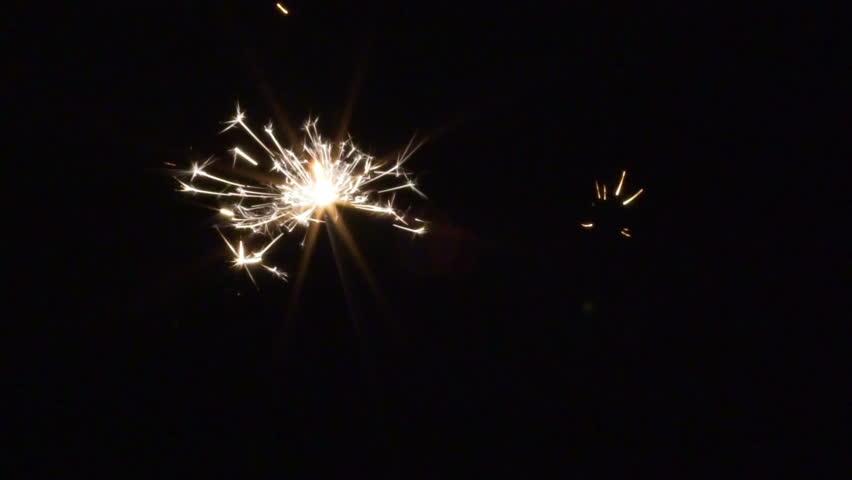 SLOW MOTION: Sparkler burning down in the dark. High speed camera (120fps)