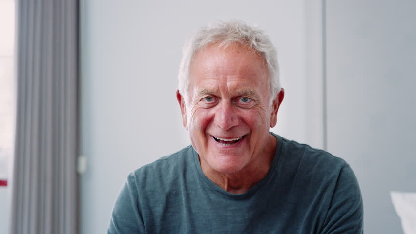 Portrait Of Senior Man At Home Laughing And Smiling At Camera | Shutterstock HD Video #1008870398
