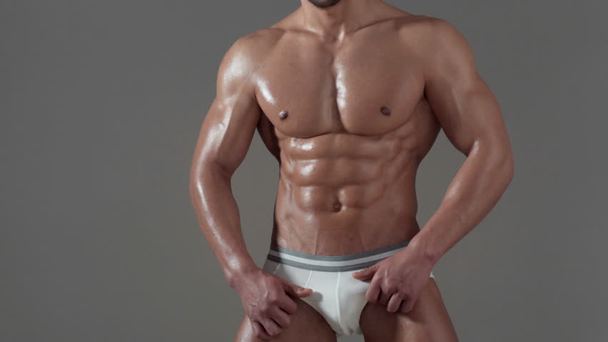 Sportsman, muscles, athlete man, triceps. Athletic caucasian, six pack, chest muscles, triceps. Beautiful male torso, ab. Biologically active additives. healthy eating. | Shutterstock HD Video #1008871586