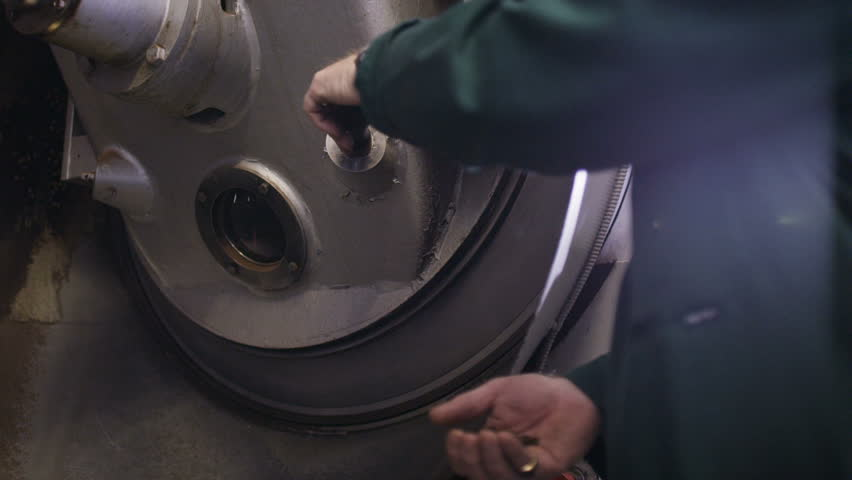 Staff working in coffee roasting manufacturing industrial plant | Shutterstock HD Video #1008897347