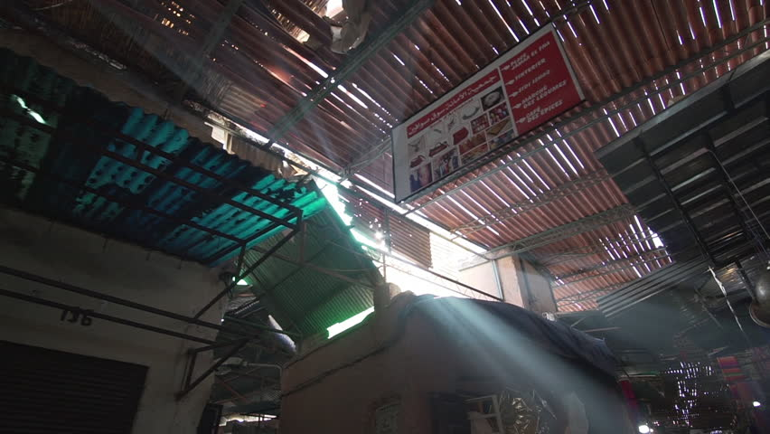 Flare and light rays in the souk of Marrakech Morocco where people sell typical and traditional home made commodities slow motion side | Shutterstock HD Video #1008908528