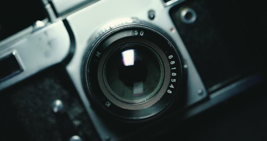 Vintage photo camera on black background | Shutterstock HD Video #1008912020