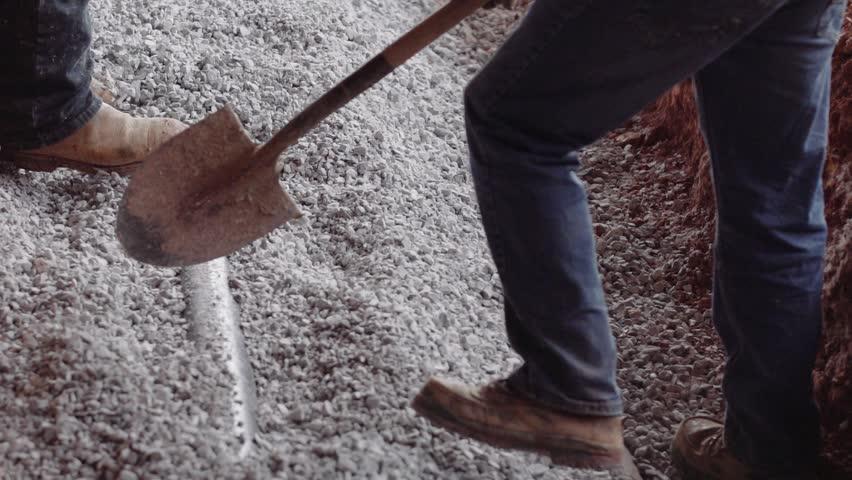 Shoveling gravel on a construction site