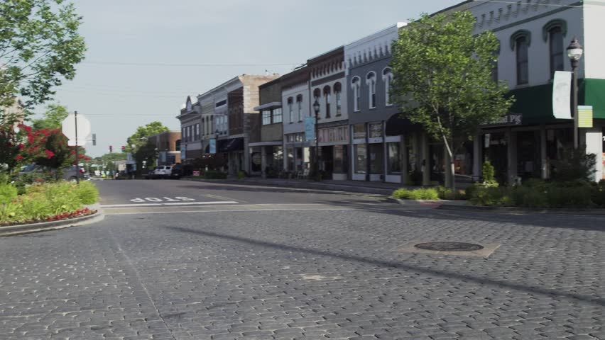 Small town streets on a sunny day | Shutterstock HD Video #1008919295