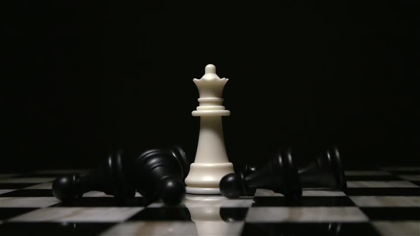 White queen piece surrounded by fallen black pawns   Shutterstock HD Video #1008924719