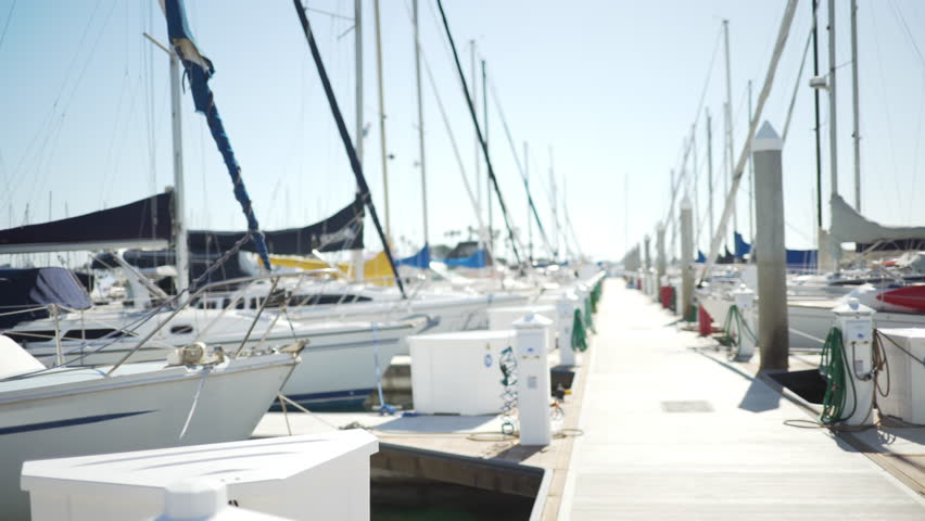 Large marina with sailing boats docked for green screen or chroma key. Out of focus or defocused shot for compositing or keying. #1008930341