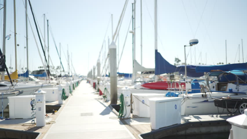 A full marina of yachts on a sunny day for green screen or chroma key. Out of focus or defocused shot for compositing or keying. #1008930344