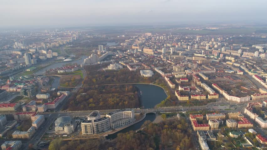 Minsk aerial drone shot autumn of the city center downtown park view from above attraction recreation yellow trees private houses on background | Shutterstock HD Video #1008932546