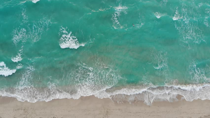 Rough wall of waves crashing view from an aerial perspective looking down at the shoreline in Miami Beach