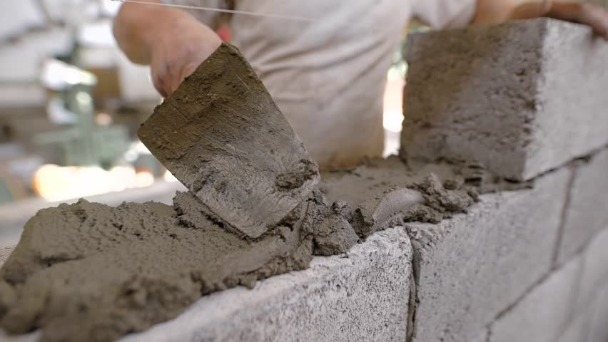 Close up of a bricklayer on a construction site with a trowel   Shutterstock HD Video #1008958091