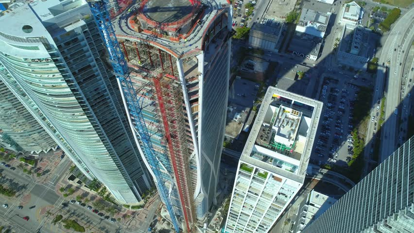 MIAMI, FL, USA - MARCH 17, 2018: Aerial drone video footage of highrise developments at Downtown Miami Biscayne 1000 Museum #1008959588