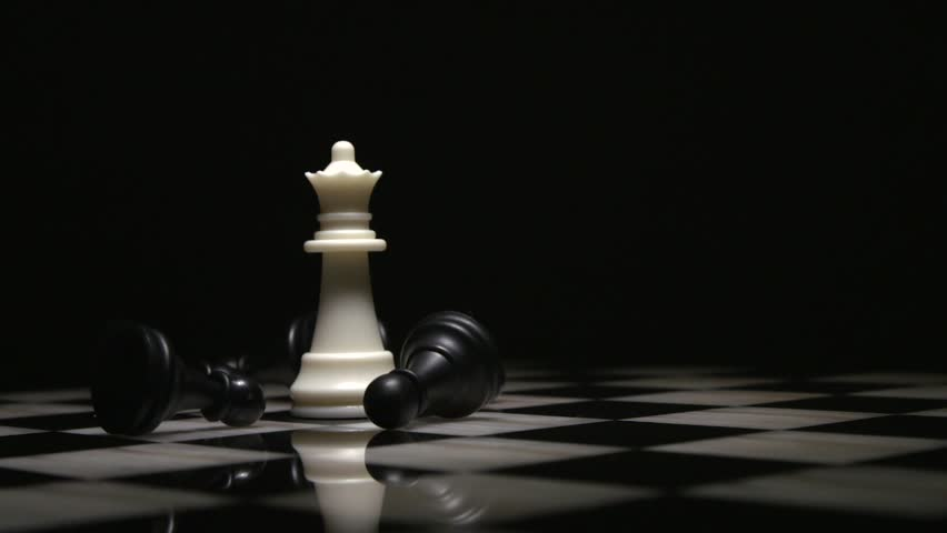 Chess queen piece surrounded by fallen black pawns   Shutterstock HD Video #1008965279