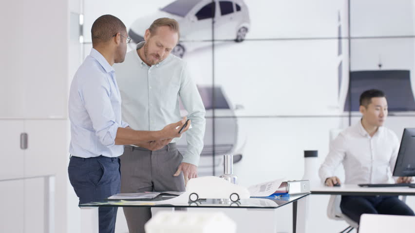 Automotive car CAD designers and engineers working on electric autonomous vehicle | Shutterstock HD Video #1008977960