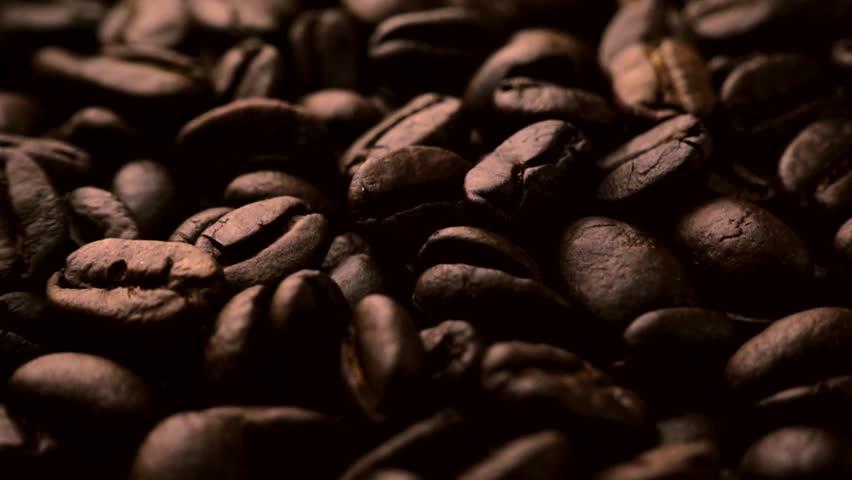 Roasted coffee beans falling in slow motion | Shutterstock HD Video #1008981242