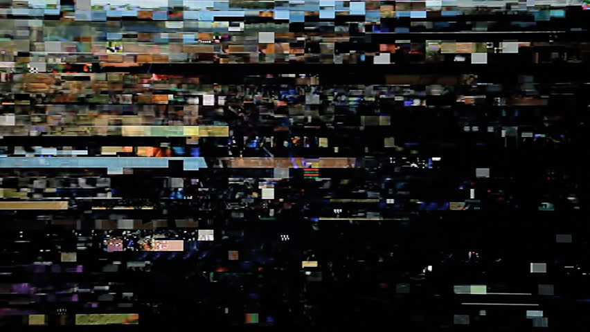 Real small glitches on the surface of an old television receiving a corrupted digital signal. Use: overlay it on your footage (add or screen mode) or mix it in.