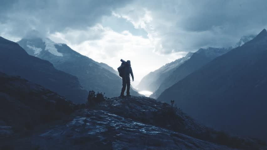 Silhouette of a mountaineer walking in the edge of summit, Santa cruz Trek, Peru. Slow motion. #1009020278