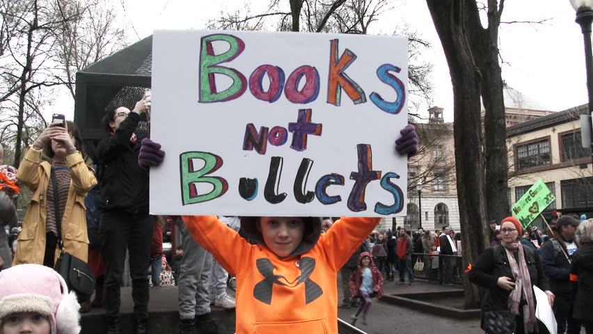 PORTLAND, OREGON / USA - MARCH 24, 2018: Little boy holds sign reading