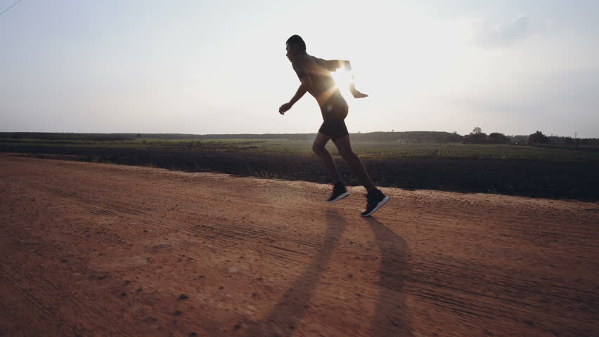 Young man runner at running for healthy.Running is an exercise as simple in order to make health of strong, Good health can not be traded,4k | Shutterstock HD Video #1009024337