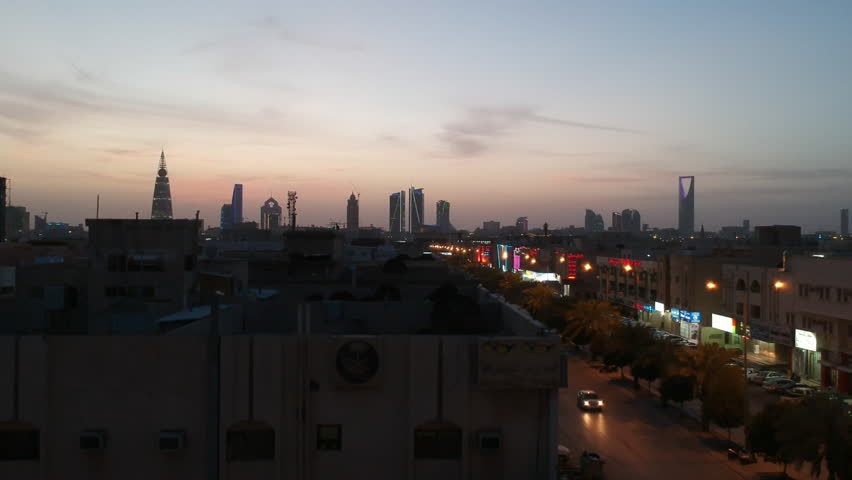 Riyadh, Saudi Arabia  - March 25, 2018: Aerial Drone Moving up to take shot of Riyadh Skyline over rooftops in a residential area