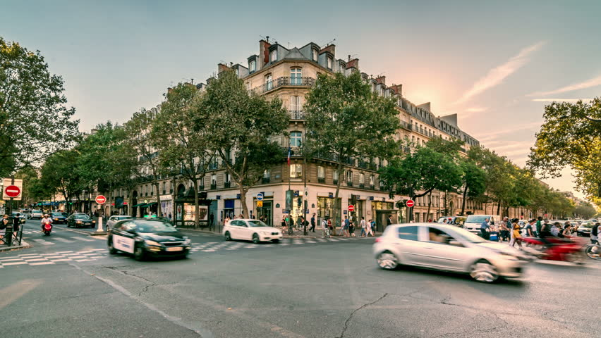 PARIS, FRANCE - CIRCA 2016: The intersection of the Boulevard Saint-Germain and Boulevard Saint-Michel. Time lapse video. Zooming in easy.