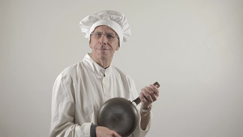 Funny cook is playing frying pan like a banjo, humor. White background