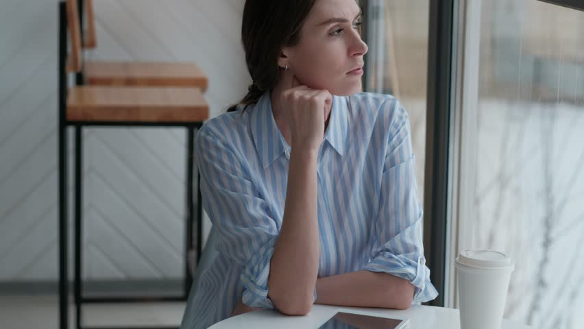 Lifestyle modern portrait of young stylish woman at cafe, thoughtfully look at the city | Shutterstock HD Video #1009079078