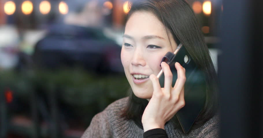 Japanese woman talking on smart phone. Tokyo, Japan | Shutterstock HD Video #1009090559
