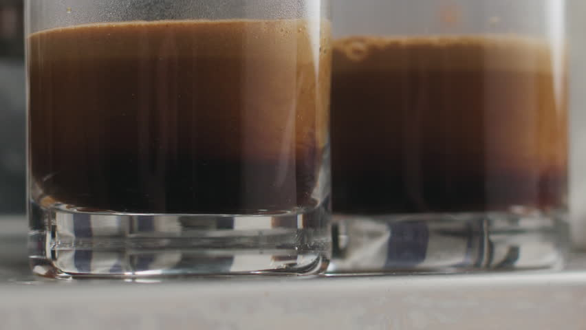 Slow motion pan preparing two espresso shots on a professional coffee machine | Shutterstock HD Video #1009100651