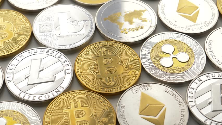 MONTREAL, CANADA - March 2018 : Bitcoin Litecoin Ethereum Ripple coins on a table | Shutterstock HD Video #1009148804
