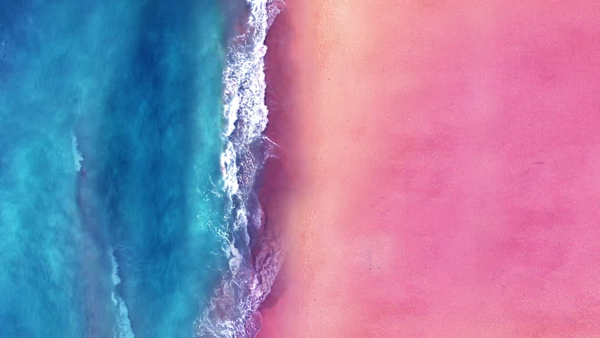 Aerial view sand beach. Top view of ocean waves. Looping Water surface texture, Sea side and pink sand, Sunset  beach seamles loop background.