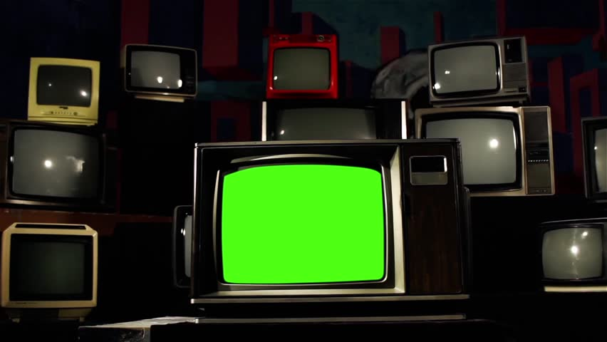 "Retro TV with Green Screen and Many Vintage TVs. Dolly Shot. Contrasted Tone. You can Replace Green Screen with the Footage or Picture you Want with ""Keying"" effect in AE (check out tutorials on YT). 