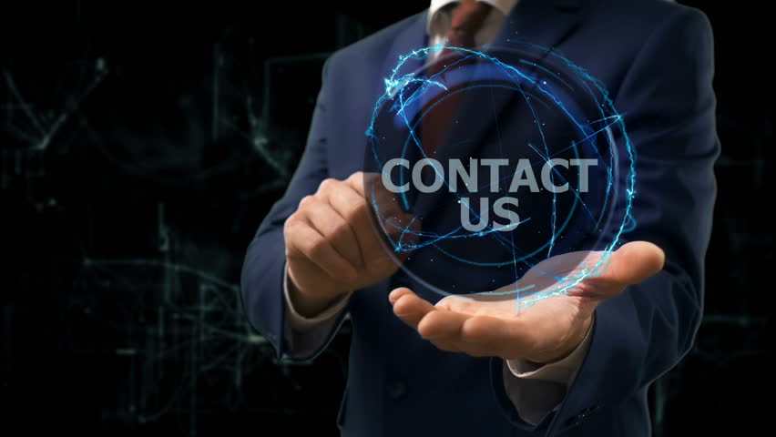 Businessman shows concept hologram contact us on his hand. Man in business suit with future technology screen at modern cosmic background