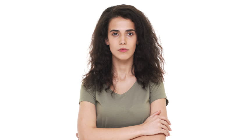 Portrait of concentrated brunette woman touching chin thinking about important things and doubting or trying to calculate best option, over white background. Concept of emotions | Shutterstock HD Video #1009163174