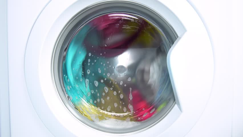 Washing machine washes colored clothing and sheets. Cylinder spinning. Nobody | Shutterstock HD Video #1009167866