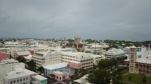 An aerial perspective of Hamilton, Bermuda and its city skyline. Soar over the Cabinet Building, Supreme Court, and the Bermuda Cathedral.