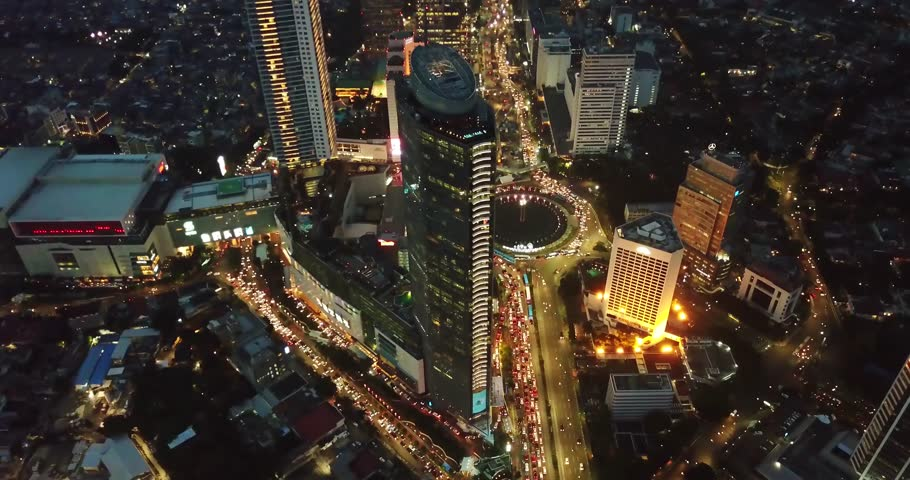 JAKARTA - Indonesia. March 19, 2018: Stunning aerial view of Hotel Indonesia roundabout with beautiful night lights from a drone. Shot in 4k resolution | Shutterstock HD Video #1009176857