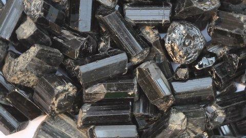 Uncut black tourmaline gemstone,motion background