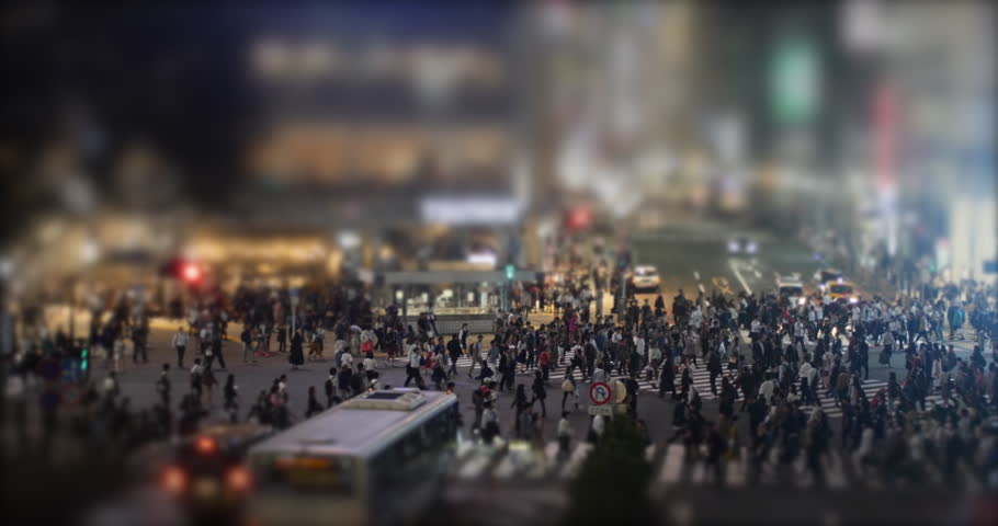 People Walking Crosswalk in Shibuya, Tokyo, Japan. Tilt Shift of crowd crossing. Night view of the most famous shopping district in Japan.