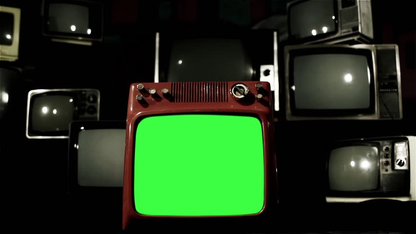 "A Retro Red TV with Green Screen Around Many Retro TVs. Dolly Shot. Contrasted Tone. You can replace green screen with the footage or picture you want with ""Keying"" effect in After Effects.  