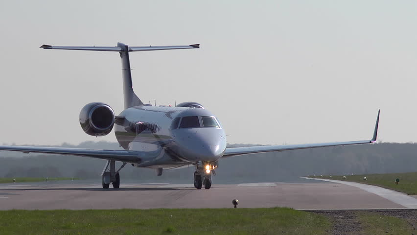 Executive jet taxiiing onto the runway at Oxford Airport. This airfield is used extensively for business and private avaiation. Royalty-Free Stock Footage #1009229588