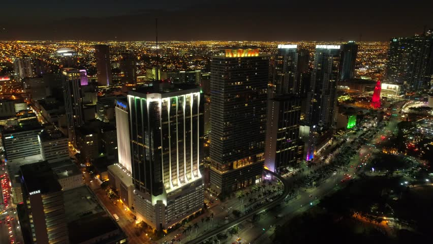 Aerial night flyby highrise residential condominiums Downtown Miami 4k