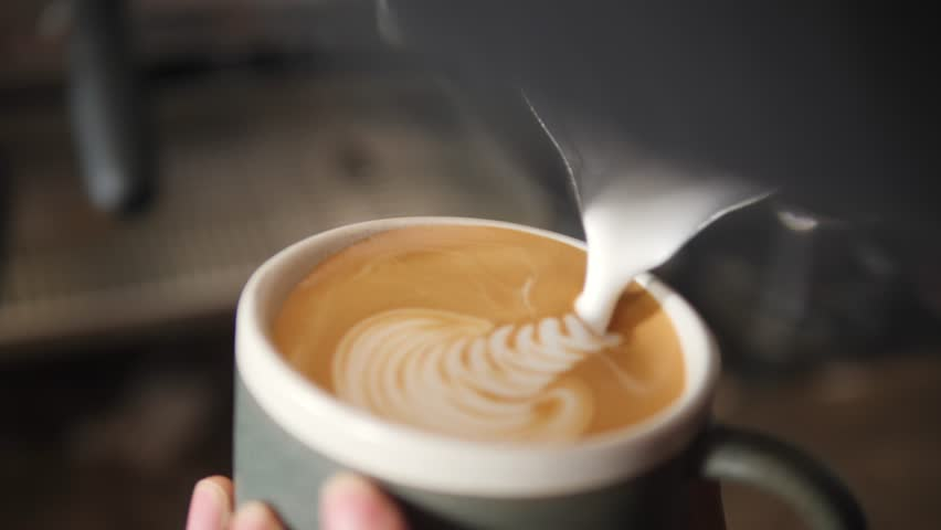 Barista Drawing Latte Art on Coffee with Soy Milk. Process of Making Vegan Lactose Free Drink in Coffeeshop. 4K, Slowmotion Macro Cinematic Closeup. #1009263284