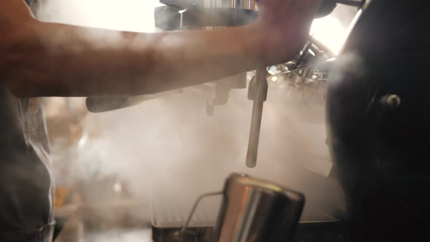Blast of Steam on Professonal Coffee Machine. Barista Working in Coffeeshop. 4K, Slowmotion. Royalty-Free Stock Footage #1009263932